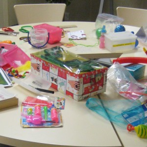 Different learning tools for children with disabliities displayed on a table.
